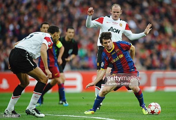 Lionel Messi of FC Barcelona in action against Rio Ferdinand and Wayne Rooney of Manchester United during the UEFA Champions League final between FC...