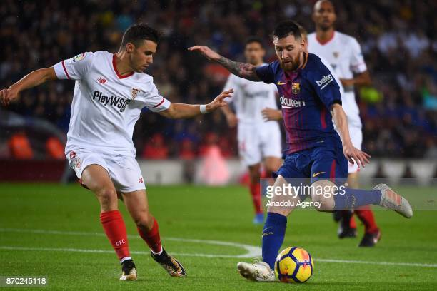 Lionel Messi of FC Barcelona in action against Sebastien Corchia of Sevilla FC during the Spanish league football match between FC Barcelona and...