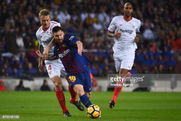 Lionel Messi of FC Barcelona in action against Simon Kjaer of Sevilla FC during the Spanish league football match between FC Barcelona and Sevilla FC...