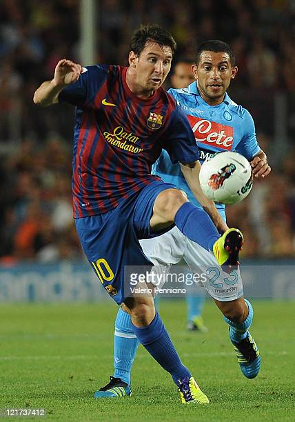 Lionel Messi of FC Barcelona in action against Walter Alejandro Guevara Gargano of SSC Napoli during the Joan Gamper Trophy match between FC...