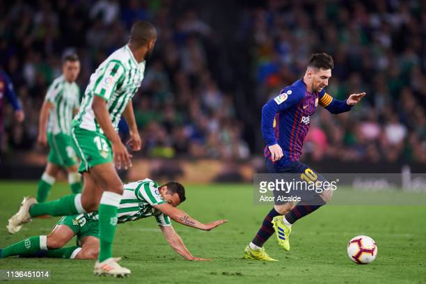 Lionel Messi of FC Barcelona in action during the La Liga match between Real Betis Balompie and FC Barcelona at Estadio Benito Villamarin on March 17...