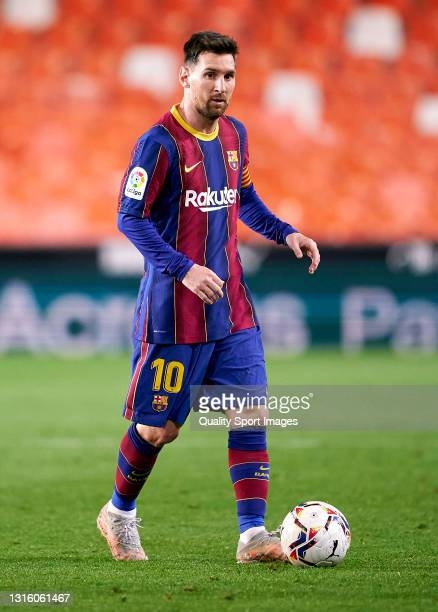 Lionel Messi of FC Barcelona in action during the La Liga Santander match between Valencia CF and FC Barcelona at Estadio Mestalla on May 02, 2021 in...