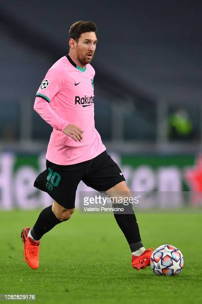 Lionel Messi of FC Barcelona in action during the UEFA Champions League Group G stage match between Juventus and FC Barcelona at Juventus Stadium on...