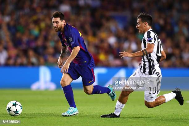 Lionel Messi of FC Barcelona in action with Paulo Dybala of Juventus during the UEFA Champions League Group D match between FC Barcelona and Juventus...