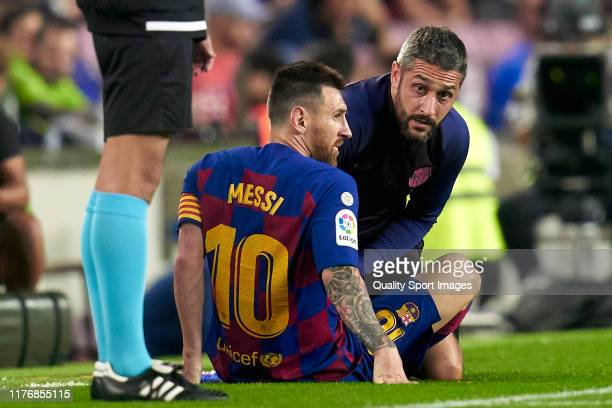 Lionel Messi of FC Barcelona injured over the pitch during the Liga match between FC Barcelona and Villarreal CF at Camp Nou on September 24, 2019 in...