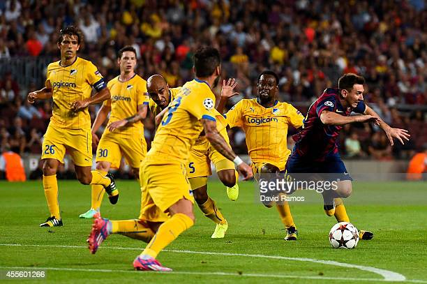Lionel Messi of FC Barcelona is brought down by Carlao of APOEL FC during the UEFA Champions League Group F match between FC Barcelona and APOEL FC...