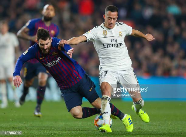Lionel Messi of FC Barcelona is brought down by Lucas Vazquez of Real Madrid CF during the Copa del Semi Final first leg match between Barcelona and...