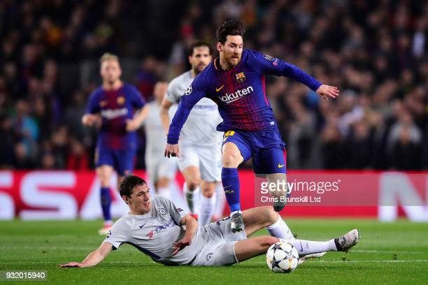 Lionel Messi of FC Barcelona is challenged by Andreas Christensen of Chelsea during the UEFA Champions League Round of 16 Second Leg match between FC...