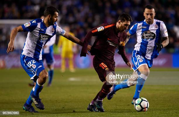 Lionel Messi of FC Barcelona is challenged by Celso Borges of Deportivo de La Coruna during the La Liga match between Deportivo La Coruna and...