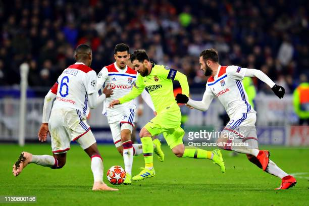 Lionel Messi of FC Barcelona is challenged by Marcelo Lucas Tousart and Houssem Aouar all of Olympique Lyonnais during the UEFA Champions League...