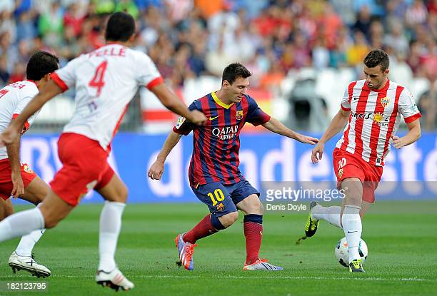 Lionel Messi of FC Barcelona is challenged by Rodrigo Rios Lozano alias 'Rodri' of UD Almeria during the La Liga match between UD Almeria and FC...