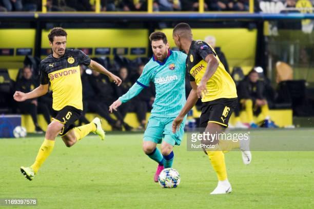 Lionel Messi of FC Barcelona is challenged by Thomas Delaney and Manuel Akanji of Borussia Dortmund during the UEFA Champions League Group F match...