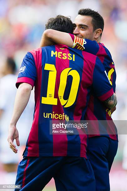 Lionel Messi of FC Barcelona is congratulated by his teammate Xavi Hernandez after scoring the opening goal during the La Liga match between FC...