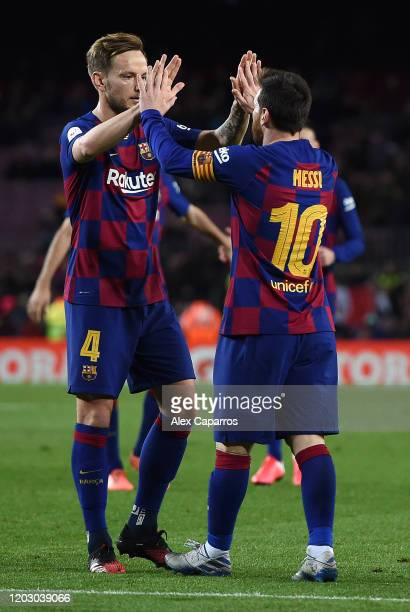 Lionel Messi of FC Barcelona is congratulated by team mate Ivan Rakitic after scoring the fifth goal during the Copa del Rey Round of 16 match...