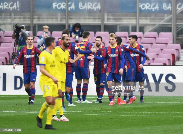 Lionel Messi of FC Barcelona is congratulated by team mates after scoring their side's first goal from the penalty spot during the La Liga Santander...