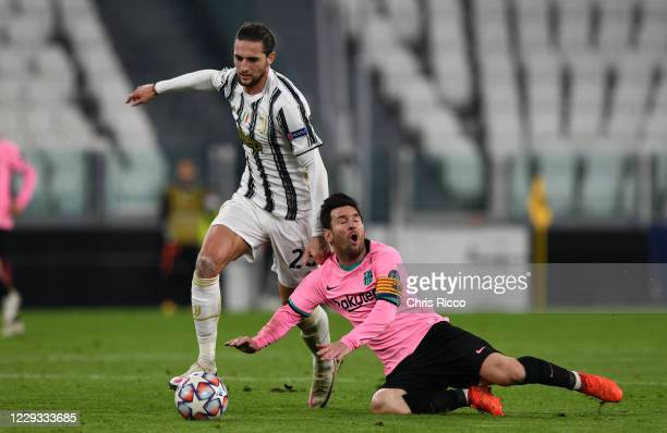 Lionel Messi of FC Barcelona is fouled by Adrien Rabiot of Juventus during the UEFA Champions League Group G stage match between Juventus and FC...