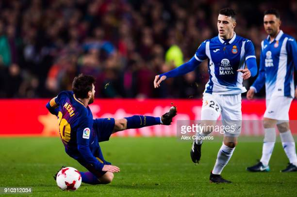 Lionel Messi of FC Barcelona is fouled by Mario Hermoso of RCD Espanyol during the Spanish Copa del Rey Quarter Final Second Leg match between FC...
