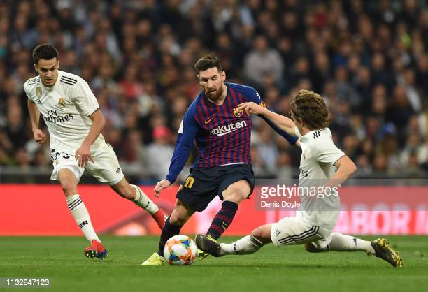 Lionel Messi of FC Barcelona is tackled by Luka Modric of Real Madrid during the Copa del Semi Final match second leg between Real Madrid and...