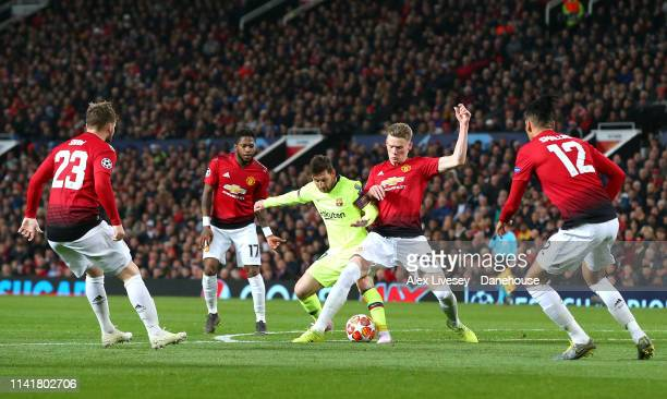 Lionel Messi of FC Barcelona is tackled by Scott McTominay of Manchester United during the UEFA Champions League Quarter Final first leg match...