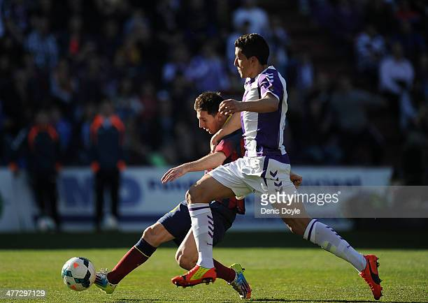 Lionel Messi of FC Barcelona is tackled by Stefan Mitrovic of Valladolid CF during the La Liga match between Real Valladolid CF and FC Barcelona at...