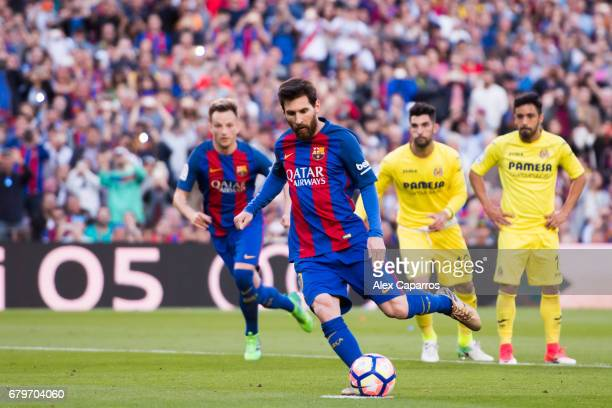 Lionel Messi of FC Barcelona kicks a penalty to score his team's fourth goal during the La Liga match between FC Barcelona and Villarreal CF at Camp...