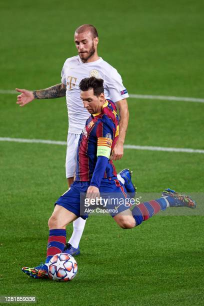 Lionel Messi of FC Barcelona kicks the ball during the UEFA Champions League Group G stage match between FC Barcelona and Ferencvaros Budapest at...
