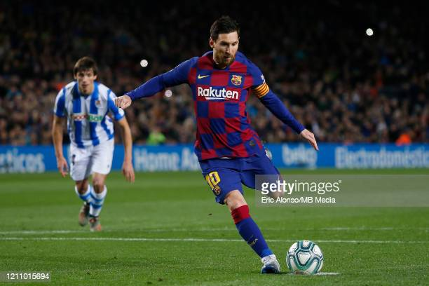 Lionel Messi of FC Barcelona kicks the ball from the penalty spot during the Liga match between FC Barcelona and Real Sociedad at Camp Nou on March...