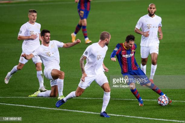 Lionel Messi of FC Barcelona kicks the ball surrounded by Ferencvaros Budapest players during the UEFA Champions League Group G stage match between...