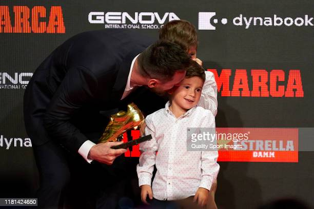 Lionel Messi of FC Barcelona kisses his son Mateo Messi after after receiving the 201819 Season European Golden Shoe award for Europe's top scorer...