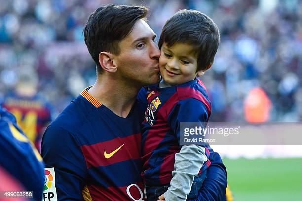 Lionel Messi of FC Barcelona kisses his son Thiago ahead of the La Liga match between FC Barcelona and Real Sociedad de Futbol at Camp Nou on...