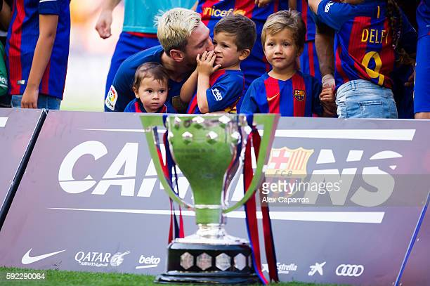 Lionel Messi of FC Barcelona kisses his son Thiago Messi as they pose with the Spanish La Liga 20152016 trophy before the La Liga match between FC...