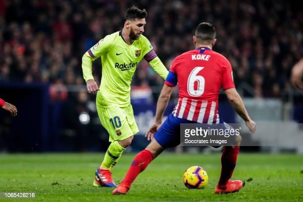 Lionel Messi of FC Barcelona Koke of Atletico Madrid during the La Liga Santander match between Atletico Madrid v FC Barcelona at the Estadio Wanda...