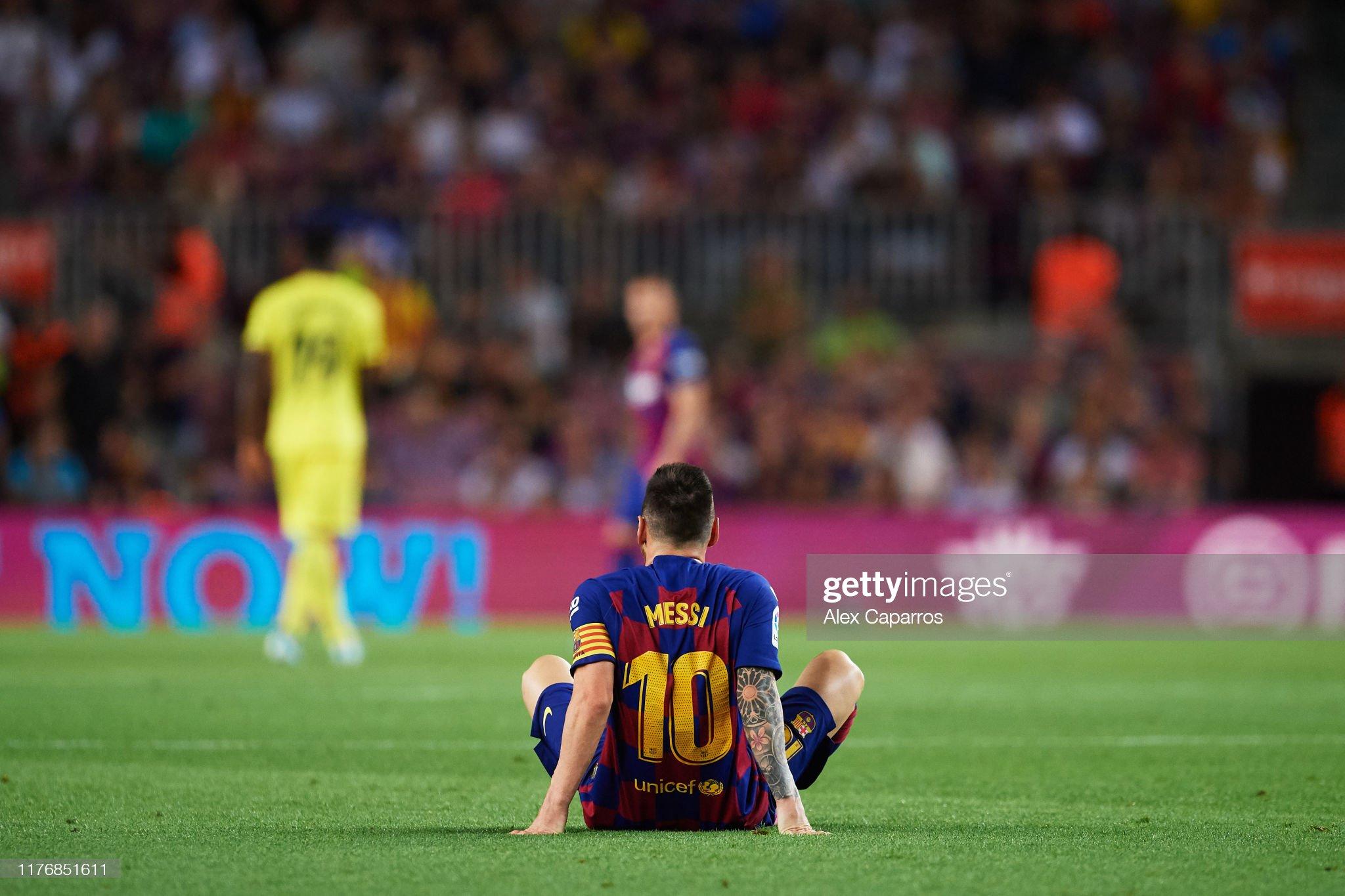 صور مباراة : برشلونة - فياريال 2-1 ( 24-09-2019 )  Lionel-messi-of-fc-barcelona-lays-on-the-pitch-during-the-liga-match-picture-id1176851611?s=2048x2048