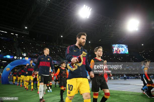 Lionel Messi of FC Barcelona leads out his team prior to the UEFA Champions League round of 16 first leg match between SSC Napoli and FC Barcelona at...