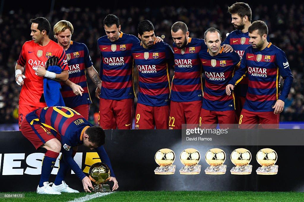Lionel Messi of FC Barcelona leaves on the pitch the FIFA Ballon d'Or trophy prior to the La Liga match between FC Barcelona and Athletic Club de Bilbao at Camp Nou on January 17, 2016 in Barcelona, Spain.