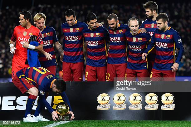Lionel Messi of FC Barcelona leaves on the pitch the FIFA Ballon d'Or trophy prior to the La Liga match between FC Barcelona and Athletic Club de...