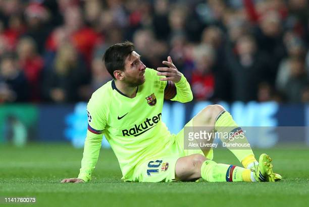 Lionel Messi of FC Barcelona lies injured during the UEFA Champions League Quarter Final first leg match between Manchester United and FC Barcelona...