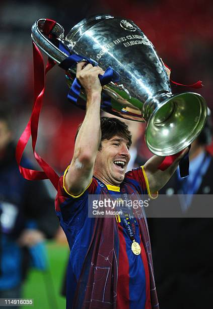 Lionel Messi of FC Barcelona lifts the trophy after victory in UEFA Champions League final between FC Barcelona and Manchester United FC at Wembley...