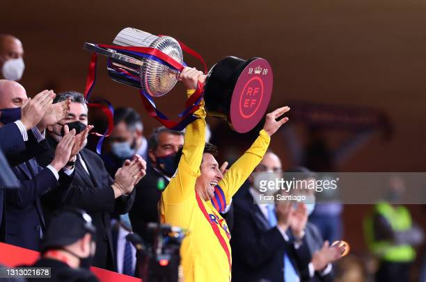 Lionel Messi of FC Barcelona lifts the trophy after winning the Copa del Rey Final match between Athletic Club and Barcelona at Estadio de La Cartuja...