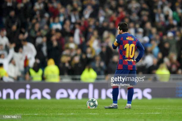 Lionel Messi of FC Barcelona looks dejected after conceding his sides second goal during the Liga match between Real Madrid CF and FC Barcelona at...