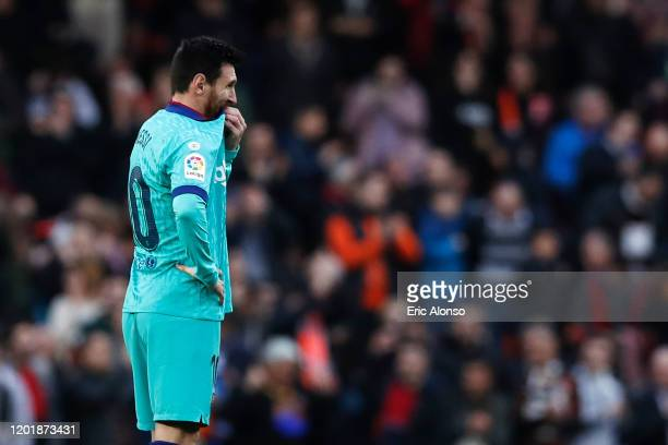Lionel Messi of FC Barcelona looks dejected after Maximiliano Gomez of Valencia scored his team's second goal during the La Liga match between...