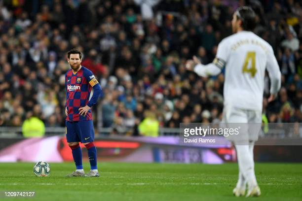 Lionel Messi of FC Barcelona looks dejected after they conceded their first goal during the Liga match between Real Madrid CF and FC Barcelona at...