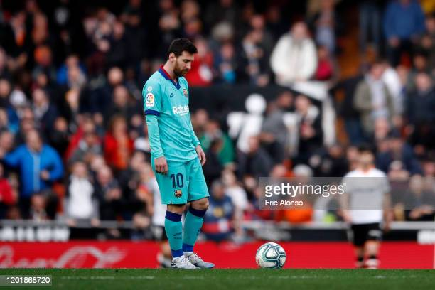 Lionel Messi of FC Barcelona looks dejected during the La Liga match between Valencia CF and FC Barcelona at Estadio Mestalla on January 25 2020 in...