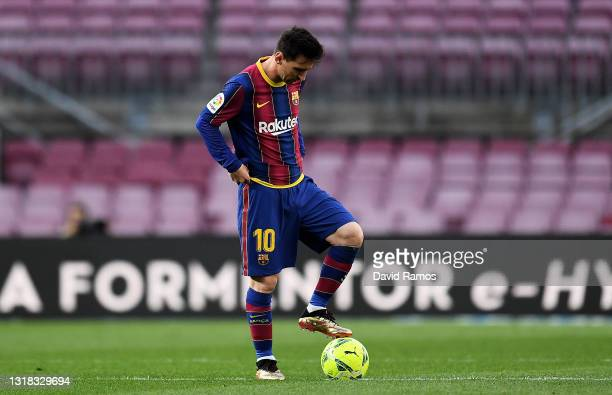Lionel Messi of FC Barcelona looks dejected during the La Liga Santander match between FC Barcelona and RC Celta at Camp Nou on May 16, 2021 in...