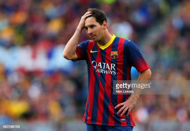 Lionel Messi of FC Barcelona looks dejected during the La Liga match between FC Barcelona and Club Atletico de Madrid at Camp Nou on May 17 2014 in...