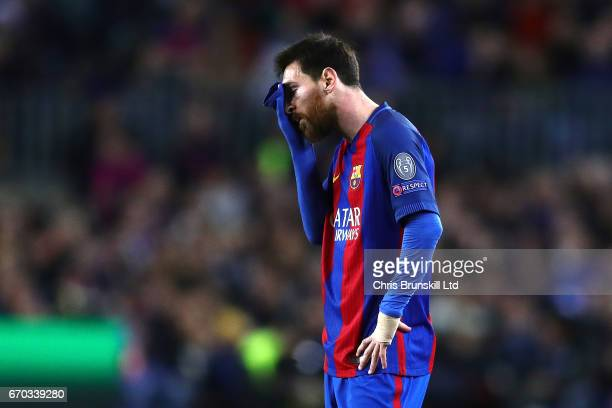 Lionel Messi of FC Barcelona looks dejected during the UEFA Champions League Quarter Final second leg match between FC Barcelona and Juventus at Camp...