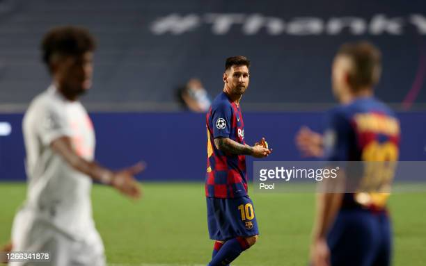 Lionel Messi of FC Barcelona looks dejected following his team's defeat in the UEFA Champions League Quarter Final match between Barcelona and Bayern...