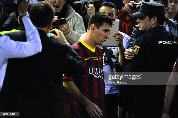 Lionel Messi of FC Barcelona looks down after being defeated during the Copa del Rey Final between Real Madrid and FC Barcelona at Estadio Mestalla...