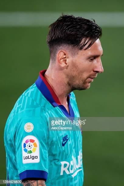 Lionel Messi of FC Barcelona looks down during the Liga match between Villarreal CF and FC Barcelona at Estadio de la Ceramica on July 05 2020 in...