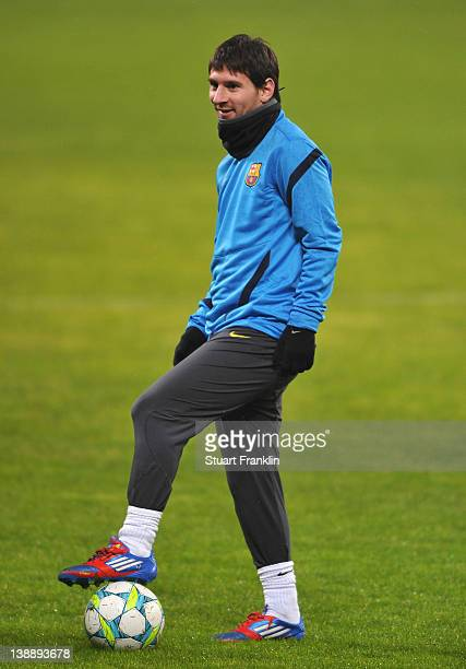 Lionel Messi of FC Barcelona looks happy during training at the BayArena on February 13 2012 in Leverkusen Germany